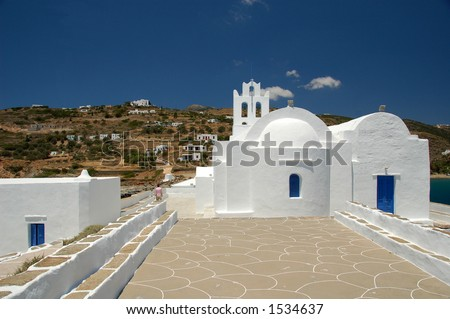 traditional whitewash chapel in an island in Greece - stock photo