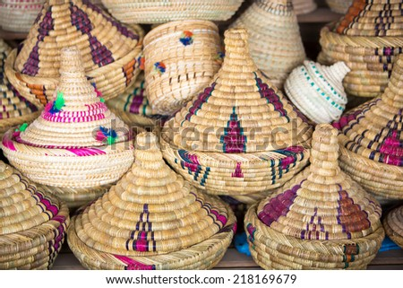 Traditional wicker tajines stacked in a shop in Marrakesh Souq or medina - stock photo