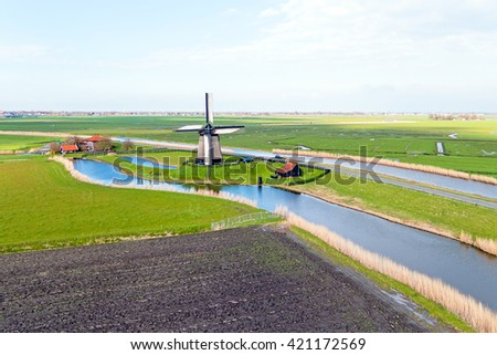 Traditional windmill in a dutch landscape in the Netherlands - stock photo