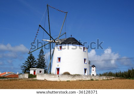 traditional windmill in portugal - stock photo