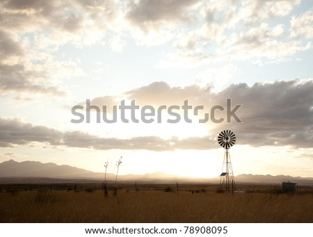 Traditional Windmill silhouetted against an evening sky - stock photo