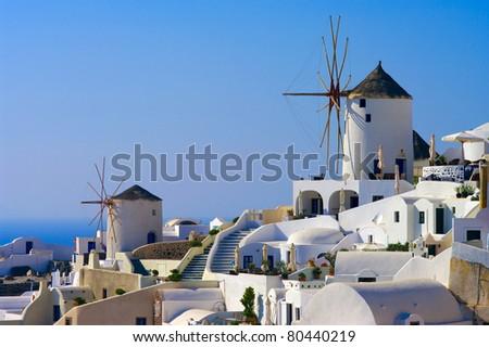 Traditional windmills in the Santorini island, Greece. - stock photo