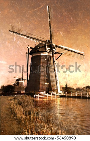 Traditional windmills  on the country side of Holland. Old Postcard. - stock photo
