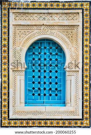 Traditional window with pattern and tiles from Sidi Bou Said in Tunisia - stock photo