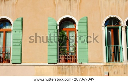 Traditional windows of building, Venice, Italy - stock photo