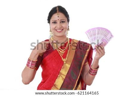 Traditional woman holding new 2000 rupee notes