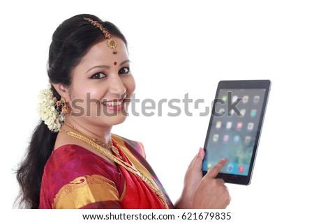 Traditional woman holding tablet computer against white background