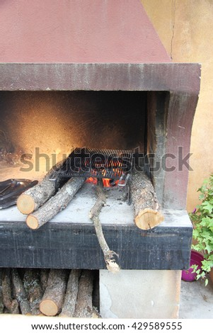 Traditional wood stove with a burning fire