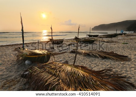 Traditional wooden boats at Diura fishing village during sunrise at the island of Batan in Batanes, Philippines