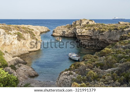 Traditional wooden boats in narrow gulf in Peloponnese, Greece - stock photo