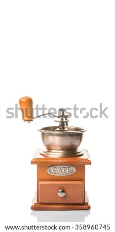 Traditional wooden coffee mill grinder over white background