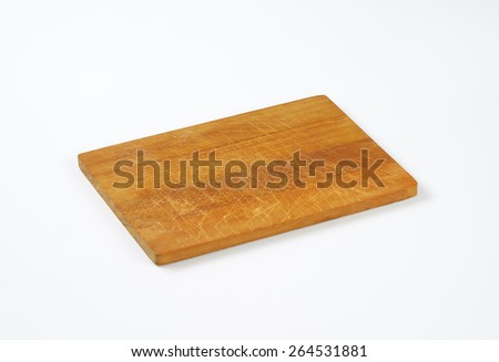 Traditional wooden cutting board on white background - stock photo