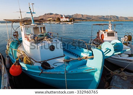 Traditional wooden fishing boats in Elafonisos island of Peloponnese, Greece - stock photo
