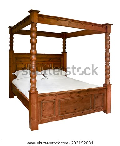 Traditional wooden Four Poster Bed isolated against a white background - stock photo