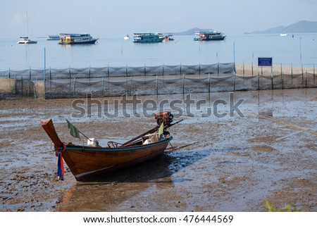 Traditional wooden longtail boat were parking on the beach (south) of Thailand