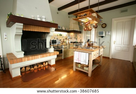 Traditional wooden provence style kitchen will all modern appliances - stock photo