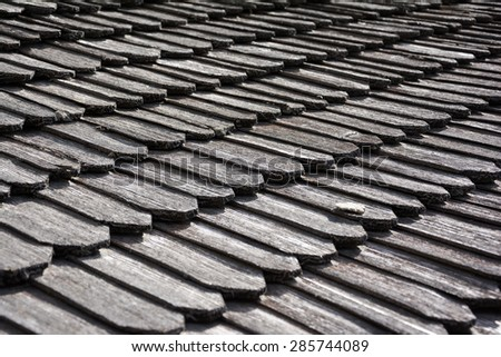 Traditional wooden roof tile of old building. Background texture. - stock photo