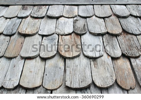 Traditional wooden roof tile of old house is background - stock photo