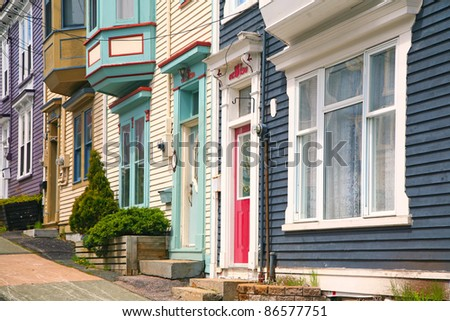Traditional wooden row houses on the hilly streets of St. John's, Newfoundland, Canada - stock photo