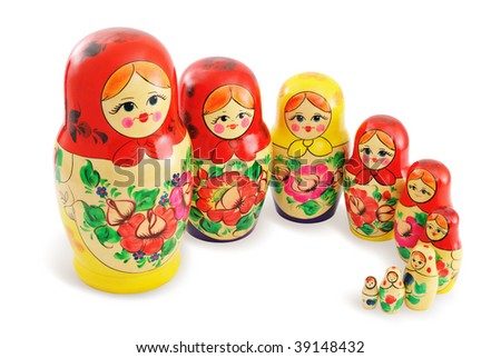 Traditional wooden Russian dolls arranged in group. Isolated on white background.