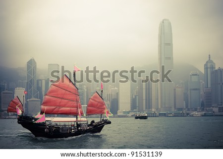 traditional wooden sailboat sailing in victoria harbor,Hong Kong. - stock photo