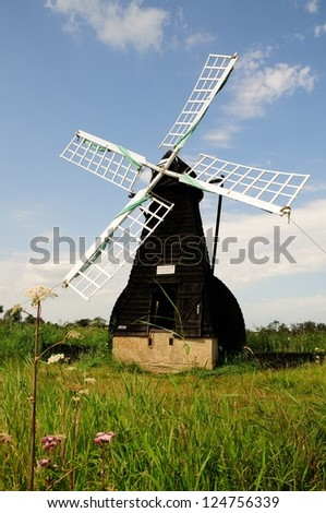 Traditional wooden windmill at Wicken Fen in Cambridgeshire - stock photo