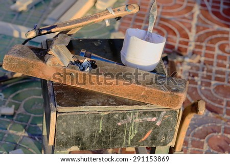 Traditional woodworking tools set aside on the street at the entry to a workshop in the lower area ot town. Gyantse cit and county-Shigatse prefecture-Tibet. - stock photo