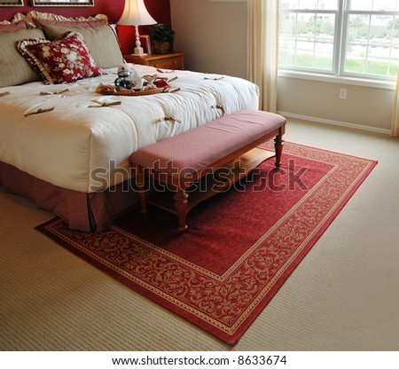 Traditional woven rug in beautiful bedroom - stock photo