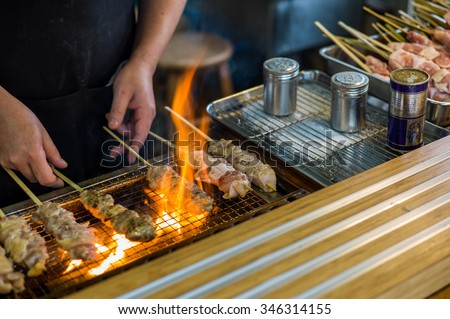 Traditional yakitori chicken stand in Japan at street food vendor market, grilled satay - stock photo