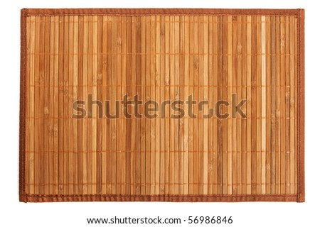 Traditional yellow bamboo pad isolated on white background - stock photo