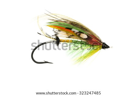Traditionally dressed Green Highlander salmon fly shot against a white background