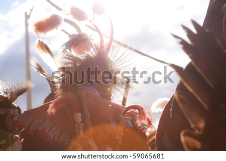Traditionally dressed Naitive American's at a powwow - stock photo