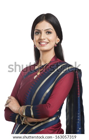Traditionally Indian woman posing in sari - stock photo