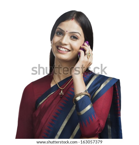 Traditionally Indian woman talking on a cell phone