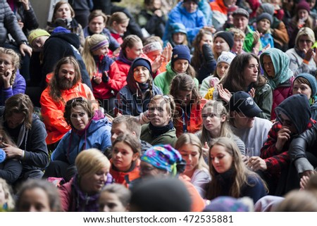 Traena, Norway - July 09 2016: audience at concert of Australian singer Ry X at cathedral cave of Kirkehelleren on Sana Island at the Traena music festival