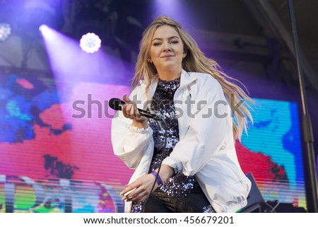 Traena, Norway - July 07 2016: concert of Norwegian singer Astrid S at Traenafestival, music festival taking place on the small island of Traena