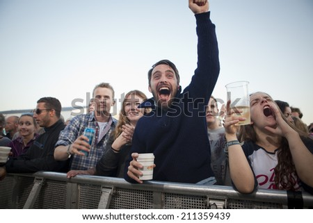 Traena, Norway - July 12 2014: during the concert of the Icelandic singer Mugison at the Traenafestival, music festival taking place on the small island of Traena - stock photo