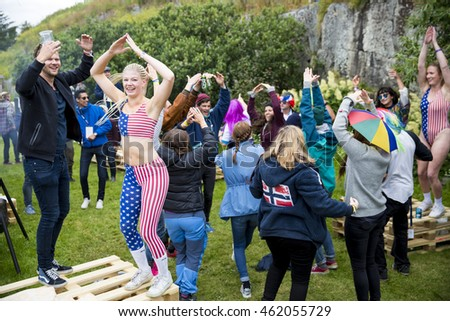 Traena, Norway - July 08 2015: group of colorful people participating in the smallest gay Pride in Europe during Traenafestival, music festival taking place on the small island of Traena.