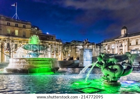 Trafalgar Square at night in London. One of the most popular tourist attraction on Earth it has more than fifteen million visitors a year. - stock photo