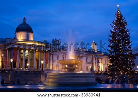 trafalgar square in christmas with christmas tree display - stock photo