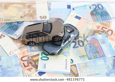 traffic accident of two toy cars in a european banknote background
