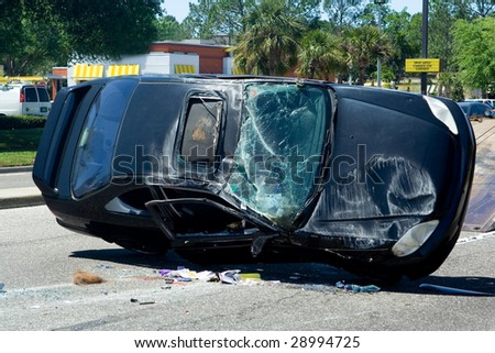 Traffic Accident Resulting in a Crushed Car - stock photo