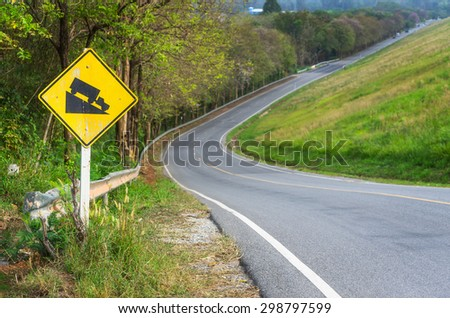 Traffic alerts downhill slope. Reduce speed and use a lower gear. Drive with caution. - stock photo