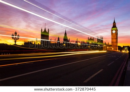 Traffic along Westminster Bridge in London at sunset with a beautiful sky and Big Ben in the distance. - stock photo