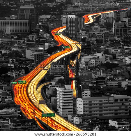 Traffic and blurred light trails in Bangkok city, Thailand - stock photo