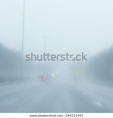 traffic and fog  - stock photo