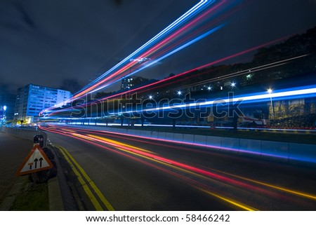 traffic at night in Hong Kong - stock photo