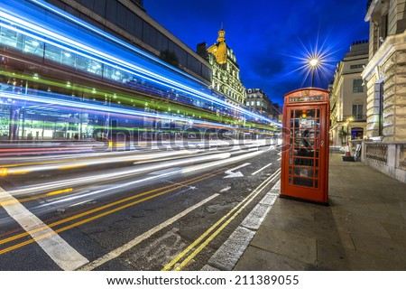 Traffic at night in the city of Westminster, London - stock photo