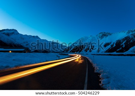 Traffic at night in the snow covered mountains