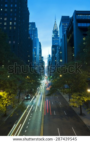 Traffic at night on 42nd Street, Tudor City Overpass, New York City - stock photo